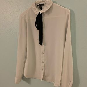 Blouse  with a  black tie